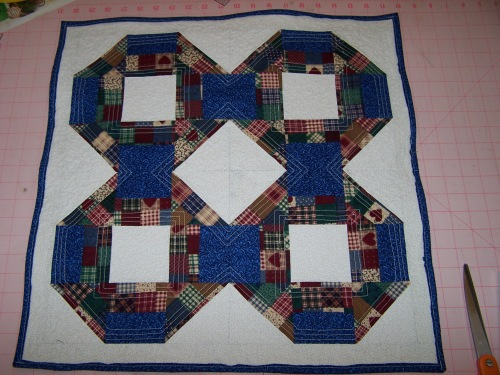 2 foot square candlemat.  $50