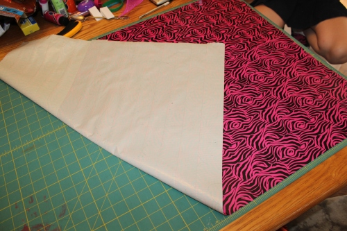 """flipping over the """"fabric"""" so the other side can be attached"""
