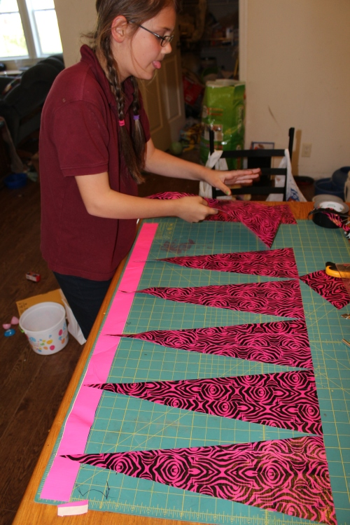 """Laying out the triangles she cut from the """"fabric"""""""